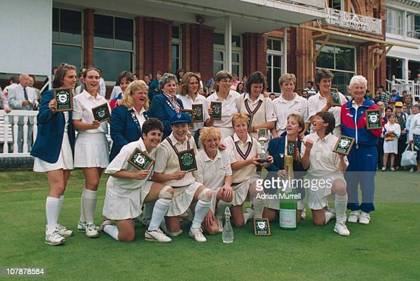 The England team celebrate their victory over New Zealand in the final of the Women's Cricket World Cup at Lord's London 1st August 1993