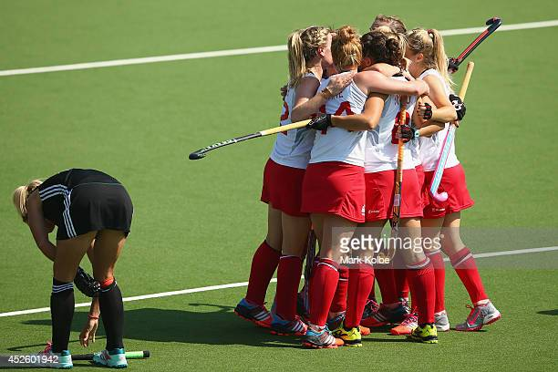 The England team celebrate with Alex Danson of England after she scored a goal during the Women's preliminary match between England and Wales at...
