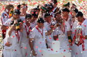 The England team celebrate with the replica urn during the presentations after day four of the npower 5th Ashes Test Match between England and...