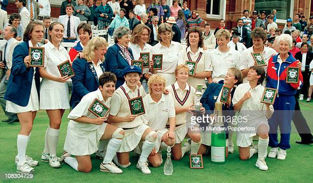 The England team celebrate with the trophy after their victory over New Zealand in the Womens World Cup Final played at Lord's Cricket Ground in...
