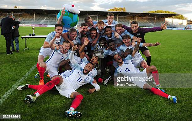 The England team celebrate with the trophy during the Final of the Toulon Tournament between England and France at Parc Des Sports on May 29 2016 in...