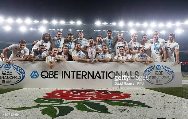 The England team celebrates after winning the QBE international match between England and Australia at Twickenham Stadium on November 29 2014 in...