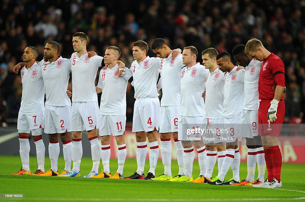 The England team hold a minute's silence for the victims who died in the Brazilian nightclub fire in Santa Maria prior the International Friendly match between England and Brazil at Wembley Stadium on February 6, 2013 in London, England.