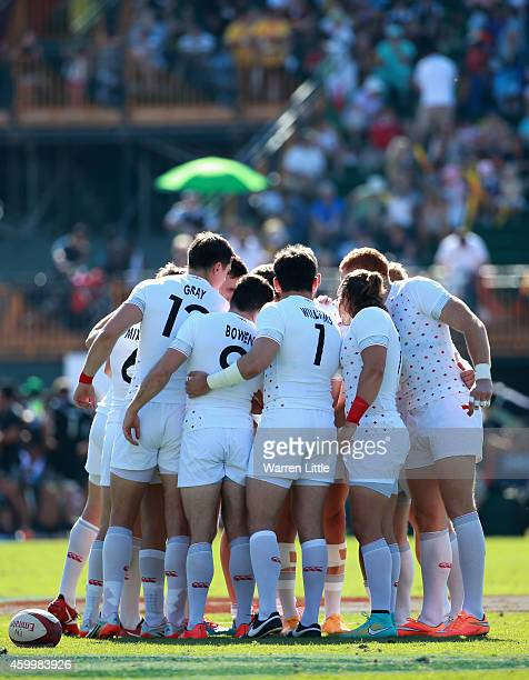 The England team huddle ahaead of their game against Kenya during day one of the Emirates Dubai Sevens HSBC Sevens World Series on December 5 2014 in...