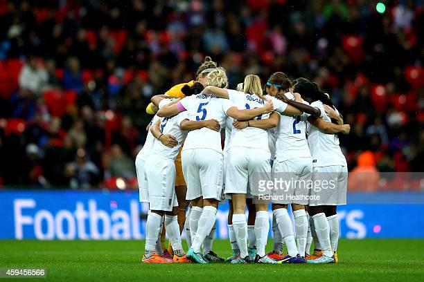 The England team huddle during the Women's International Friendly match between England and Germany at Wembley Stadium on November 23 2014 in London...
