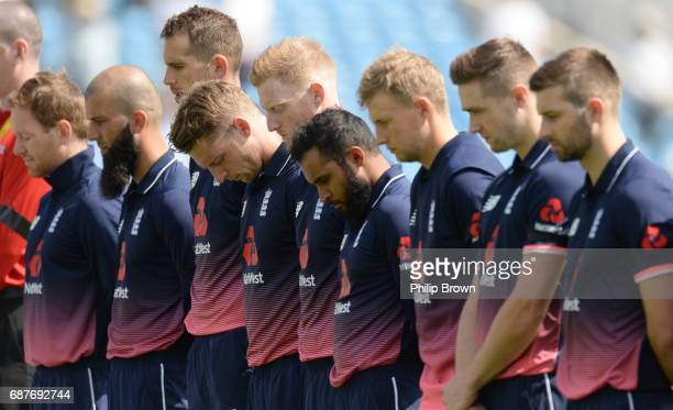 The England team including captain Eoin Morgan Moeen Ali Alex Hales and Jos Buttler line up for a minute of silence in respect after the Manchester...