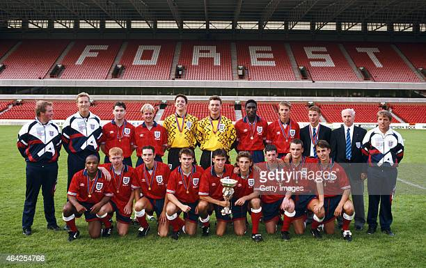 The England team pictured with the trophy after beating Turkey 10 to win the UEFA Under18 Championship Final at the City Ground on July 25 1993 in...