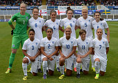 The England team pose for a group photo ahead of the Women's International Friendly match between England and Sweden at Victoria Park on August 3...