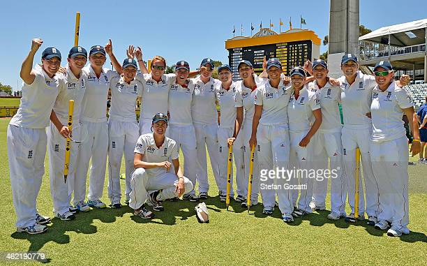 The England team pose for a photo after winning the Ashes test against Australia on day four of the Women's Ashes Test match between Australia and...
