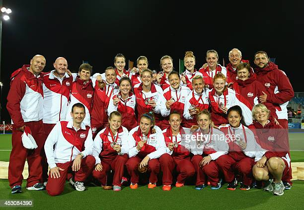 The England team pose with their Silver Medals after winning the Silver Medal in the Women's Gold Medal Final match between Australia and England at...
