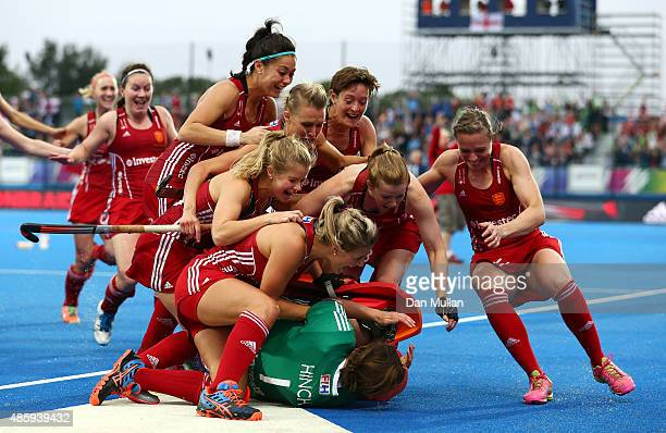 The England team run to celebrate with Maddie Hinch of England after victory saving a penalty during the EuroHockey Womens Gold Medal match between...