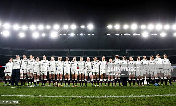 The England team sing their national anthem prior to kickoff during the Women's Six Nations match between England and Ireland at Twickenham Stadium...