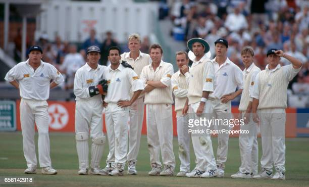 The England team wait for the television umpire to rule on a runout attempt by England captain Mike Atherton during the 3rd Texaco Trophy One Day...
