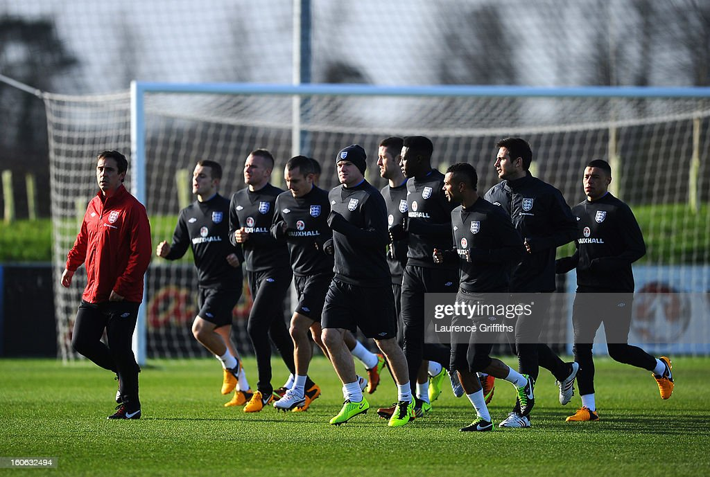 The England Team warm up during a training session at St Georges Park on February 4, 2013 in Burton-upon-Trent, England.
