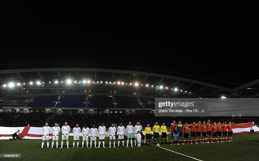 The England U21 and Austria U21 teams line up before the International match between England U21 and Austria U21 at Amex Stadium on March 25, 2013 in Brighton, England.