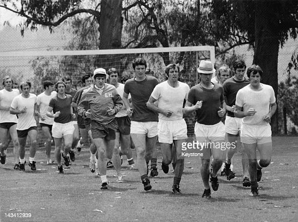 The England World Cup football team in training Mexico City May 1970 Wearing hats are players Emlyn Hughes and Bobby Charlton