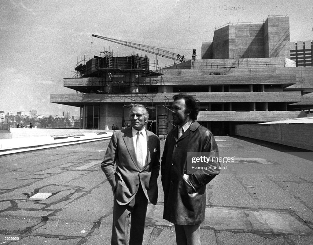 The English actor and director Laurence Olivier, and the English theatre director Sir Peter Hall on the terrace of the National Theatre, London. Original Publication: People Disc - HW0666