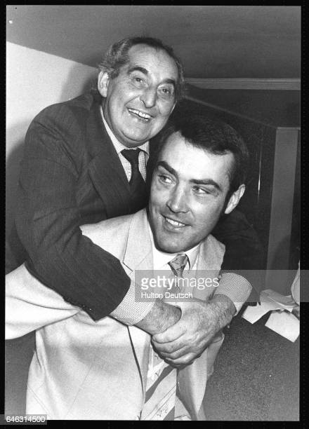 The English boxer Alan Minter gives a piggy back to Keith Castle at the Men of the Year Awards at the Savoy Hotel 1980 Minter held the European...