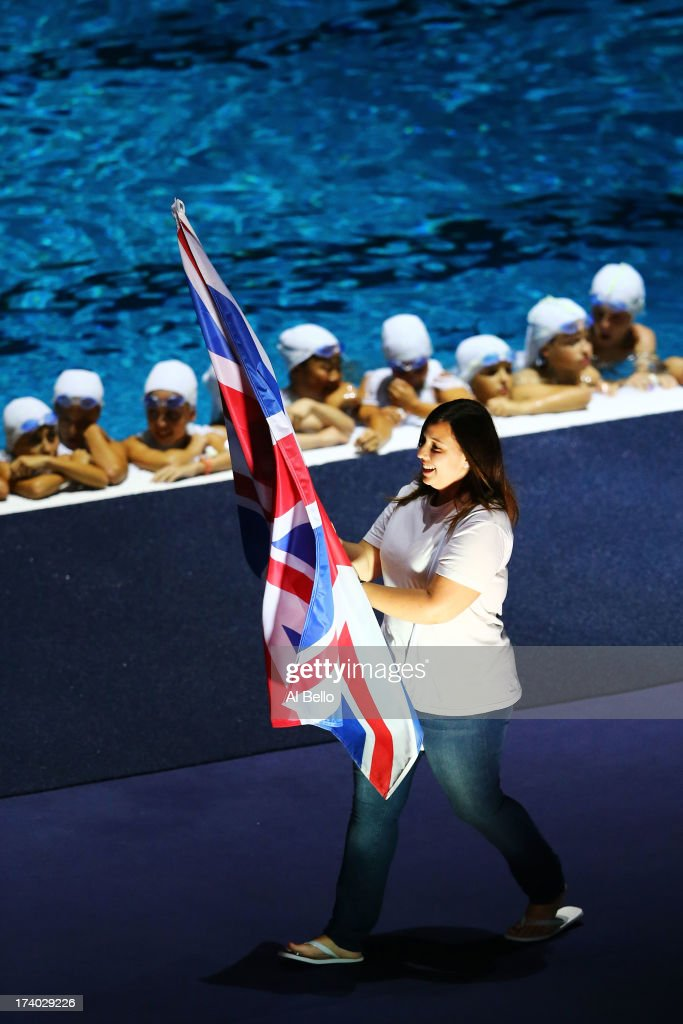 The English flag bearer is seen during the parade of the 180 delegations during Opening Ceremony of the 15th FINA World Championships at Palau Sant Jordi on July 19, 2013 in Barcelona, Spain.
