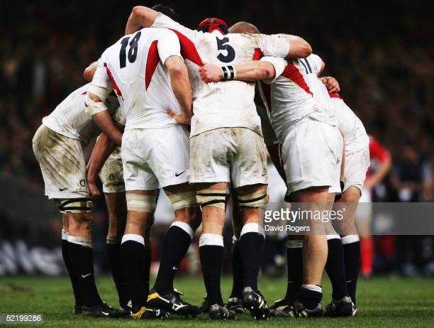 The English Forwards huddle during the Six Nations match between Wales and England at the Millennium Stadium on February 5 2005 in Cardiff Wales