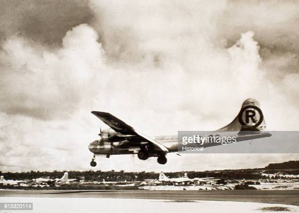 The Enola Gay lands back on Tinian after dropping the first military atomic bomb on Hiroshima