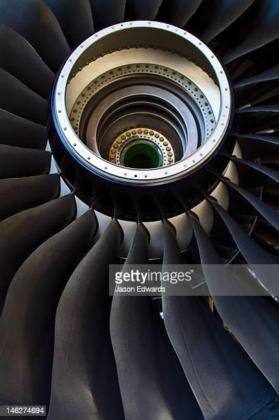 The enormous spiralling blades of a jet airliner turbofan engine.