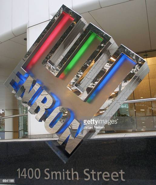 The Enron logo is seen January 23 2002 in front of the companys corporate headquarters in Houston TX Federal prosecuters and the FBI are...