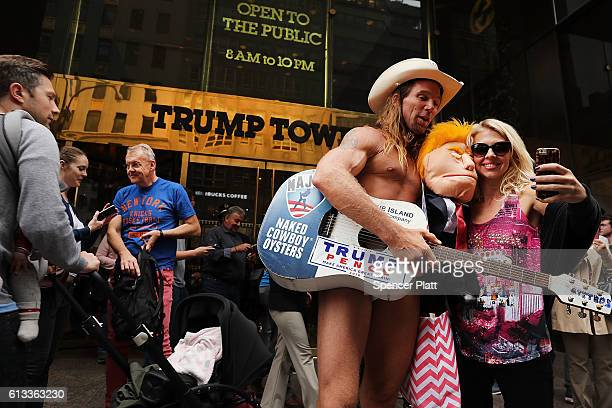 The entertainer Naked Cowboy stands in front of Trump Tower in Manhattan on October 8 2016 in New York City The Donald Trump campaign has faced...