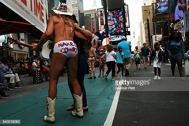 The entertainer who goes by the name Naked Cowboy performs in Times Square on the first day that the new rules for performers in Times Square went...