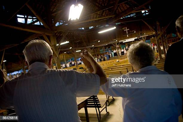 The entire campmeeting holds hands around the tabernacle as they sing to close out this year's campmeeting as the final song of the final service on...