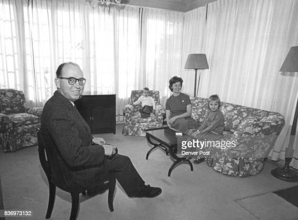 The entire family from left ConsulGeneral Claude Batault JeanClaude 3 Mrs Batault and Sylvie is seated in the 'little' living room a sunny room of...