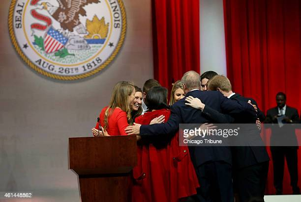 The entire Rauner family shares in a big group hug after Bruce Rauner was sworn in as governor on Monday Jan 12 2015 at the Prairie Capital...
