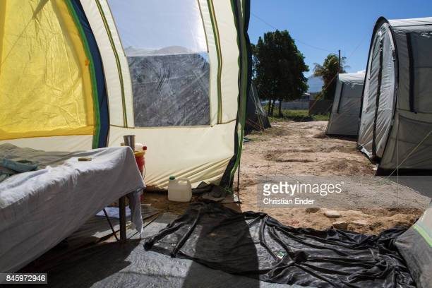 PortauPrince Haiti December 09 2012 The entrance and parts of a bed in Close up at the string that stabilize a tent in the refugee camp Parc Colofe...