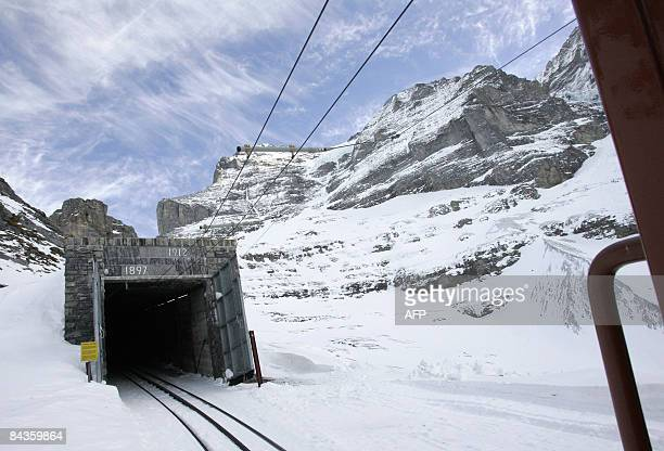 The entrance of the 73km long railway tunnel that brings tourists to the highest railway station in Europe Jungfraujoch at an altitude of 3454 meters...