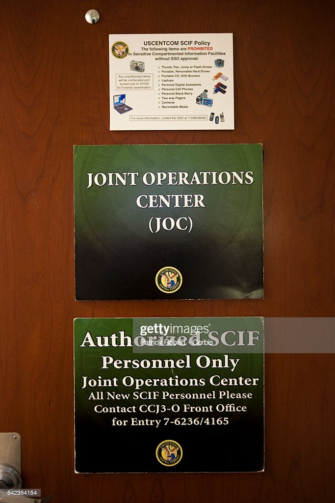 The entrance of the Joint Operations Center from where all current conflicts are commanded at the United States Central Command Computer screens are...