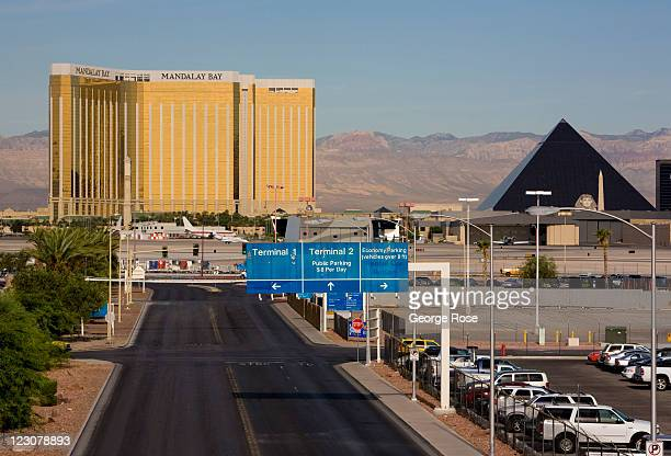 The entrance to a longterm parking lot at McCarran International Airport is viewed with Mandalay Bay Hotel in the background on August 12 in Las...