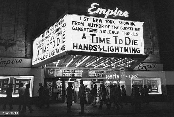 The entrance to an Empire cinema advertising 'A Time To Die' 8th Avenue New York City USA 1983