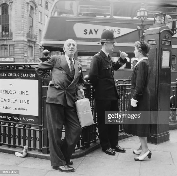 The entrance to Piccadilly Circus Underground Station in London 1953 Original Publication Picture Post 6576 What Makes Piccadilly pub 4th July 1953