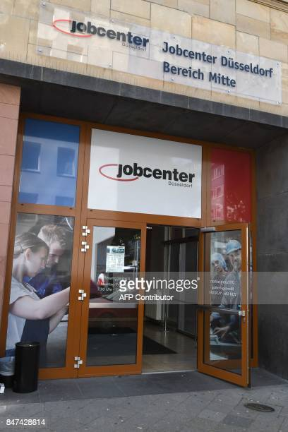 The entrance to the Jobcenter in DuesseldorfMitte western Germany on August 25 2017 The number of people out of work has halved in Germany since 2005...