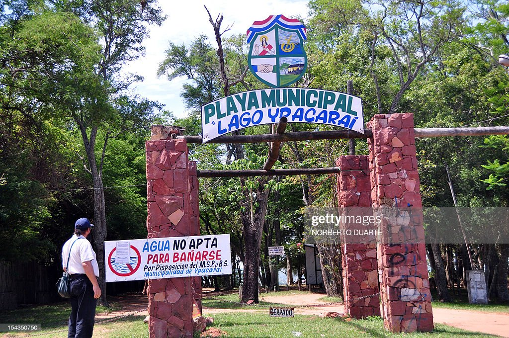 The entrance to to municipal beach at Ypacarai Lake, with a placard informing that its waters are not suitable for bathing, in Ypacarai, Paraguay on October 18, 2012. Paraguay's Health Minister Antonio Corbo said that water samples from the lake analized in Sao Paulo, Brazil with the backing of the Pan American Health Organization determined that the bacteria found in the lake's waterweed present a high level of neurologic and liver toxicity.