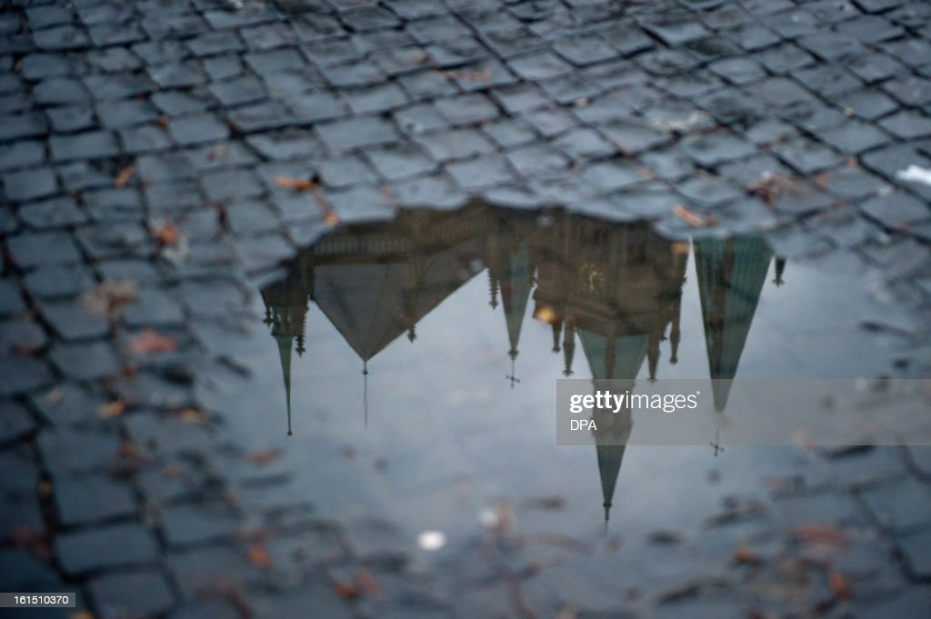 The Erfurt's cathedral reflects in a puddle on February 11, 2013.