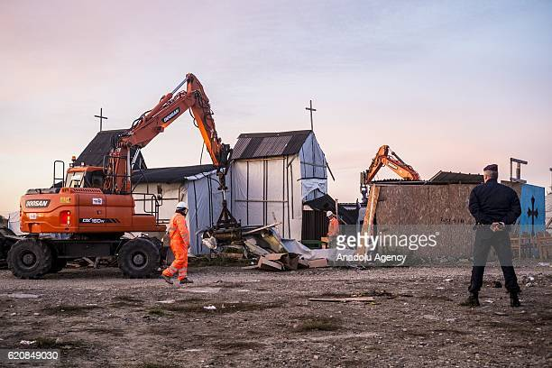 The Eritrean church last place of worship of the jungle is destroyed by workers and bulldozers in Calais on November 3 2016 Over 350 women and Their...