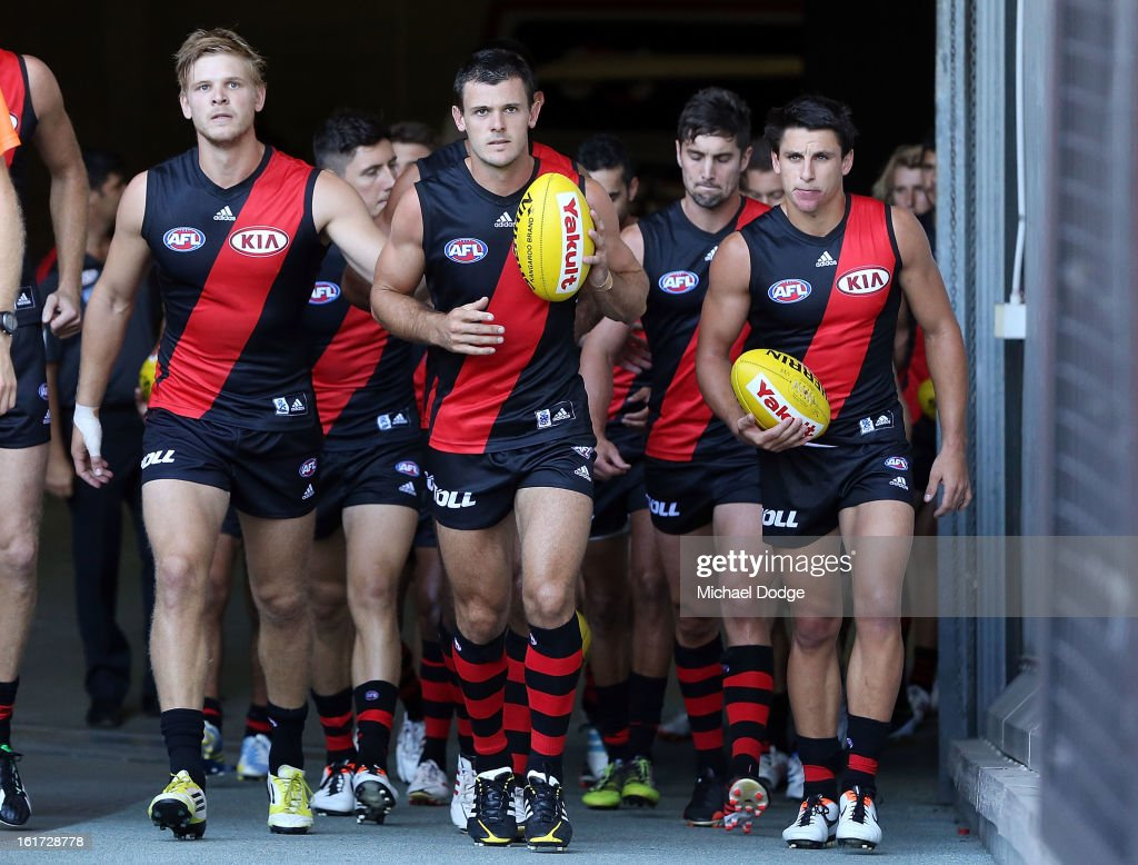 The Essendon Bombers lead by Brent Stanton walk onto the arena for the round one AFL NAB Cup match between the Essendon Bombers and the Western Bulldogs at Etihad Stadium on February 15, 2013 in Melbourne, Australia.