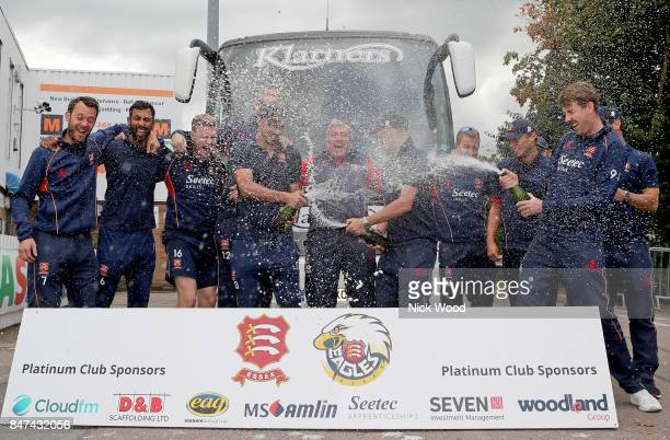 The Essex players spray champagne for the press as Essex Celebrate winning the Specsavers County Championship at the Cloudfm County Ground on...