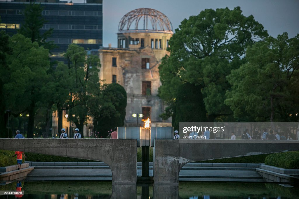 The eternal flame burns as the Atomic Bomb Dome stands behind, inside Peace Memorial Park on May 26, 2016 in Hiroshima, Japan. On May 27, President Barack Obama is scheduled to visit Hiroshima, which will be the first time a U.S. president makes an official visit to the site where an atomic bomb was dropped at the end of World War II.