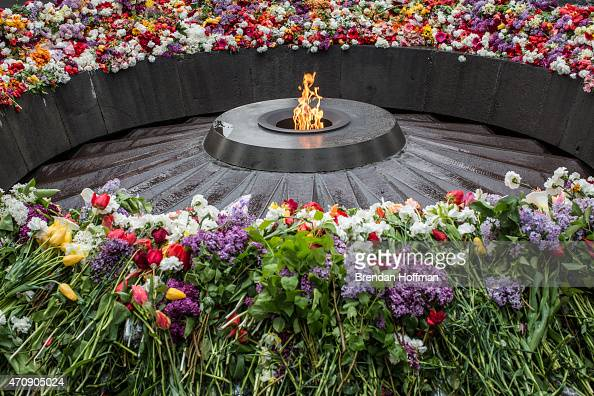 The eternal flame burns at the Armenian genocide memorial on April 24 2015 in Yerevan Armenia Armenians today are marking the one hundredth...