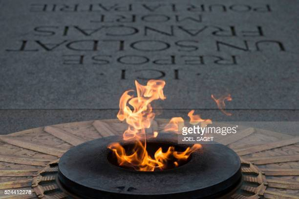 The eternal flame that burns in front of the Tomb of the Unknown Soldier is pictured during a ceremony with the Governor general of Australia and the...