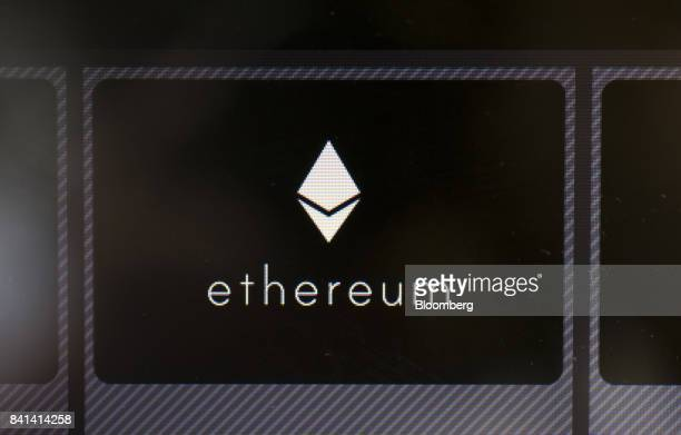 The ethereum virtual currency logo is displayed on an automated teller machine at the Coin Trader bitcoin retail store in Tokyo Japan on Wednesday...