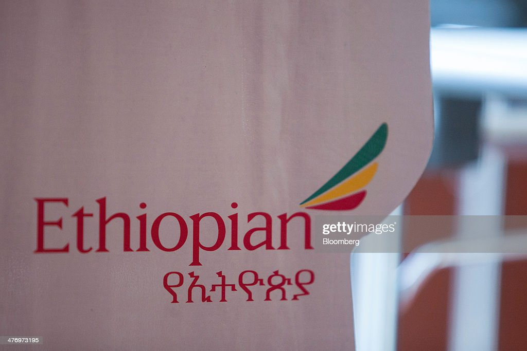 The Ethiopian Airlines Enterprise logo sits on display during a news conference at the ITB travel fair at Messe Berlin exhibition center in Berlin, Germany, on Thursday, March 6, 2014. Ethiopian Airlines said it will locate its fourth hub in the Democratic Republic of Congo as Africa's No. 2 carrier seeks to tap Chinese economic links and fill long-haul flights to destinations such as Brazil. Photographer: Krisztian Bocsi/Bloomberg via Getty Images