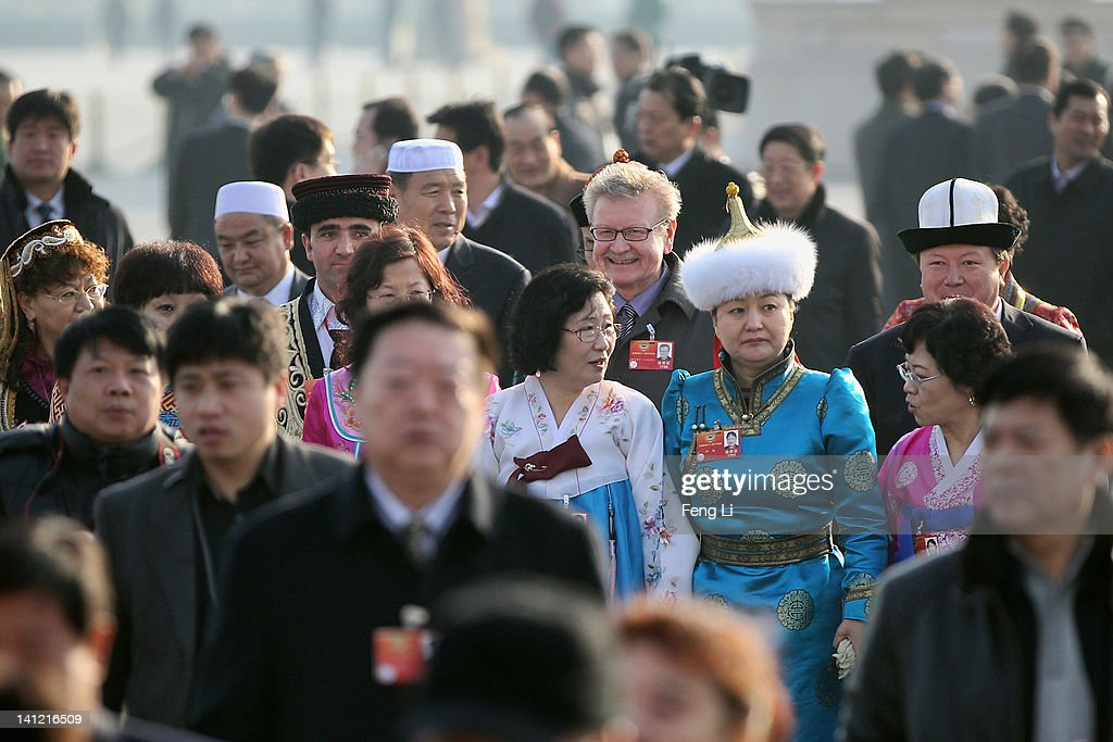 The ethnic minority delegates arrive at the Great Hall of the People before the closing ceremony of the Chinese People's Political Consultative Conference (CPPCC) on March 13, 2012 in Beijing, China. Known as 'liang hui,' or 'two organizations', it consists of meetings of China's legislature, the National People's Congress (NPC), and its advisory auxiliary, the Chinese People's Political Consultative Conference (CPPCC).